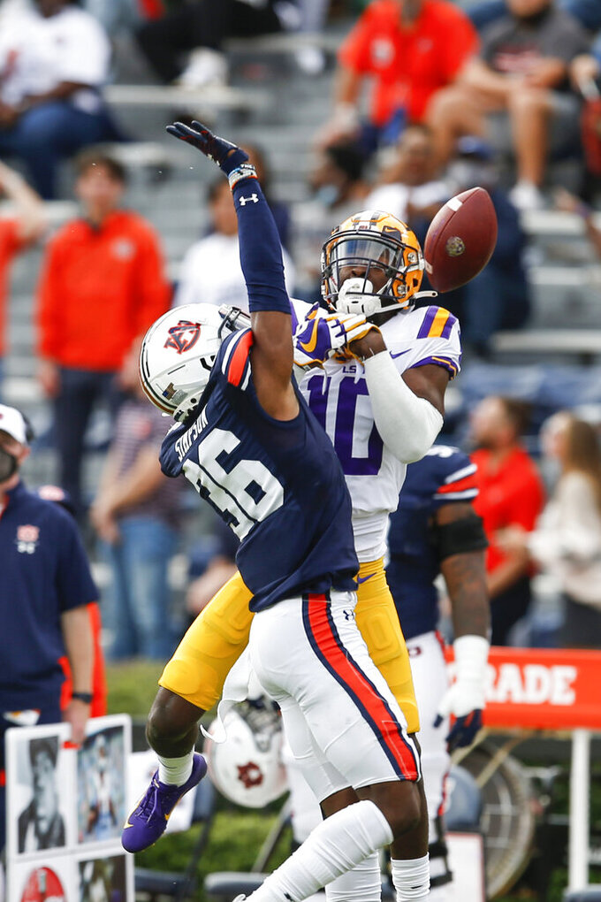 Auburn defensive back Jaylin Simpson (36) breaks up a pass intended for LSU wide receiver Jaray Jenkins (10) during the first quarter of an NCAA college football game on Saturday, Oct. 31, 2020, in Auburn, Ala. (AP Photo/Butch Dill)