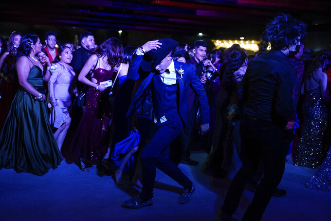 Young people dance during prom at the Grace Gardens Event Center in El Paso, Texas on Friday, May 7, 2021. Around 2,000 attended the outdoor event at the private venue after local school districts announced they would not host proms this year. Tickets cost $45. (AP Photo/Paul Ratje)