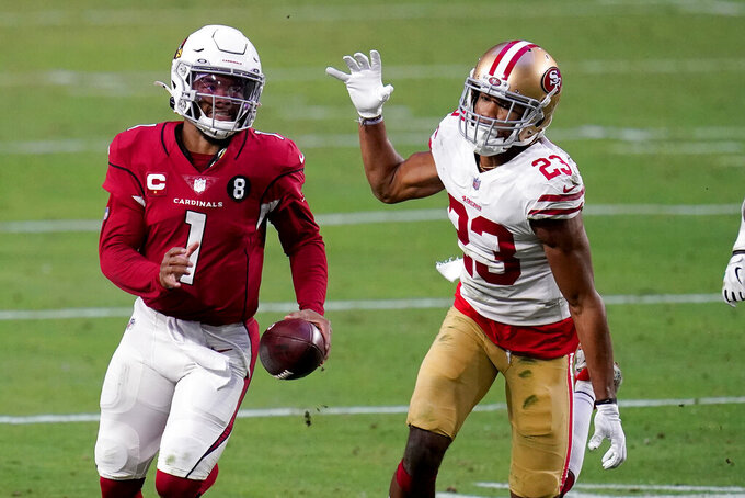 FILE - In this Dec. 26, 2020, file photo, Arizona Cardinals quarterback Kyler Murray (1) runs ahead of San Francisco 49ers cornerback Ahkello Witherspoon (23) during the second half of an NFL football game Glendale, Ariz. Murray has already established that he's a very good passer in the NFL. But it's his added ability to run that made him truly elite at times last season. Now the Cardinals have to decide how much they want Murray to run in his third season while also trying to keep him healthy.  (AP Photo/Ross D. Franklin, File)