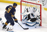 Buffalo Sabres forward Kyle Okposo (21) is stopped by San Jose Sharks goalie Martin Jones (31) during the first period of an NHL hockey game Tuesday, Oct. 22, 2019, in Buffalo, N.Y. (AP Photo/Jeffrey T. Barnes)