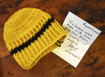 A beanie crocheted by Natchez. Miss., Mayor Darryl Grennell sits on his coffee table. With every beanie that he creates, Grennell includes a personalized note asking for God's blessing on the wearer. (Ben Hillyer/The Natchez Democrat via AP)