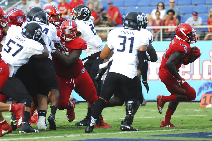 Florida Atlantic running back Kerrith Whyte Jr. (6) scores a touchdown in the second quarter against. Old Dominion during an NCAA college football game Saturday, Oct. 6, 2018, in Boca Raton, Fla. (Jim Rassol/South Florida Sun-Sentinel via AP)