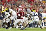 Nebraska's Rahmir Johnson (14) rushes against Michigan's Gemon Green (22) during the second half of an NCAA college football game Saturday, Oct. 9, 2021, in Lincoln, Neb. (AP Photo/Rebecca S. Gratz)