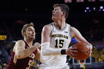 Michigan center Jon Teske (15) looks to shoot as Elon forward Federico Poser (5) defends during the second half of an NCAA college basketball game Friday, Nov. 15, 2019, in Ann Arbor, Mich. (AP Photo/Carlos Osorio)