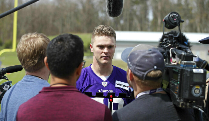 Minnesota Vikings rookie Austin Cutting talks with reporters after rookie minicamp workouts began at the NFL football team's complex Friday, May 3, 2019, in Eagan, Minn. Cutting became the first Air Force player drafted in 20 years when the Vikings took the long snapper in the seventh round. Pursuing a pro football career isn't so simple, though, with required military service to be sorted out first for Cutting. (AP Photo/Jim Mone)