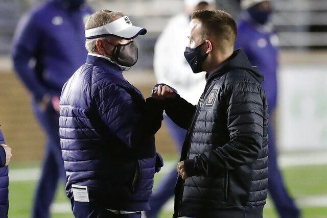 Boston College head coach Jeff Hafley, right, greets Notre Dame head coach Brian Kelly following an NCAA college football game, Saturday, Nov. 14, 2020, in Boston. (AP Photo/Michael Dwyer)