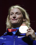 Gold medalist in the women's pole vault Anzhelika Sidorova, who participates as a neutral athlete, poses during the medal ceremony at the World Athletics Championships in Doha, Qatar, Monday, Sept. 30, 2019. (AP Photo/Nariman El-Mofty)