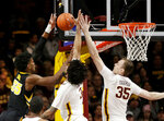 Iowa forward Tyler Cook (25) has his shot blocked by Minnesota forward Jordan Murphy (3) and Minnesota center Matz Stockman (35) during the first half of an NCAA college basketball game Sunday, Jan. 27, 2019, in Minneapolis. (AP Photo/Andy Clayton-King)