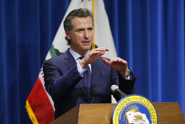 FILE - In this May 14, 2020, file photo, California Gov. Gavin Newsom discusses his revised 2020-2021 state budget during a news conference in Sacramento, Calif. Newsom's proposed budget cuts include canceling billions of dollars in climate change spending, a blow to environmental advocates who look to the state as a stopgap for the Trump administration's weakening of federal protections. (AP Photo/Rich Pedroncelli, Pool, File)
