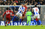 Brighton & Hove Albion's Glenn Murray, left, and Liverpool's Fabinho jump for the ball during the English Premier League soccer match between Brighton and Hove Albion and Liverpool F.C at the Vitality Stadium, Brighton England. Saturday, Jan. 12, 2019. (Gareth Fuller/PA via AP)