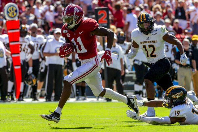 FILE - In this Sept. 21, 2019, file photo, Alabama wide receiver Henry Ruggs (11) runs in for a touchdown on a pass reception against Southern Mississippi during the first half of an NCAA college football game in Tuscaloosa, Ala. The Los Angeles Raiders selected Ruggs in the first round of the NFL draft. (AP Photo/Vasha Hunt, File)