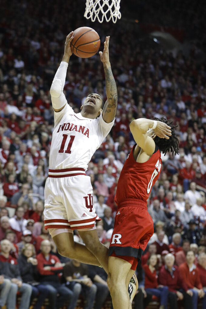 Indiana guard Devonte Green (11) puts up a shot against Rutgers guard Geo Baker (0) during the second half of an NCAA college basketball game, Sunday, March 10, 2019, in Bloomington, Ind. Indiana won 89-73. (AP Photo/Darron Cummings)