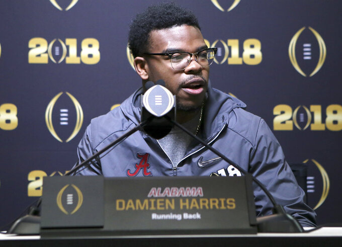 FILE - In this Jan. 6, 2018, file photo, Alabama running back Damien Harris (34) meets with the media during the College Football Playoff national championship media day at Philips Arena in Atlanta. Harris bucked the trend of Alabama's recent starting tailbacks, who follow up big seasons with an early departure for the NFL. Instead, Harris opted to stick around for his senior season and has a chance to become the first Crimson Tide rusher with three 1,000-yard seasons. (C.B. Schmelter/Chattanooga Times Free Press via AP, File)
