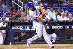 New York Mets' Javier Baez hits a single during the second inning of a baseball game against the Miami Marlins, Wednesday, Aug. 4, 2021, in Miami. (AP Photo/Lynne Sladky)