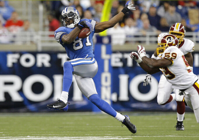 FILE - In this Oct. 26, 2008, file photo, Detroit Lions wide receiver Calvin Johnson makes catch against the Washington Redskins in the fourth quarter of an NFL football game in Detroit. Peyton Manning, Charles Woodson, Jared Allen and Calvin Johnson are first-year eligible players to make the list of 25 semifinalists for the Pro Football Hall of Fame's class of 2021. (AP Photo/Paul Sancya, File)