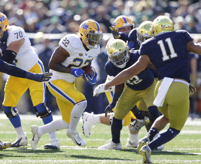 Pittsburgh running back Darrin Hall (22) runs against Notre Dame safety Alohi Gilman (11 during the first half of an NCAA college football game, Saturday, Oct. 13, 2018, in South Bend, Ind. (AP Photo/Darron Cummings)