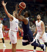 United States' Kemba Walker trips as he tries to shoot past Serbia's Bogdan Bogdanovic at left during a consolation playoff game for the FIBA Basketball World Cup in Dongguan in southern China's Guangdong province on Thursday, Sept. 12, 2019. The U.S. will leave the World Cup with its worst finish ever in a major international tournament, assured of finishing no better than seventh after falling to Serbia 94-89 in a consolation playoff game on Thursday night. (AP Photo/Ng Han Guan)