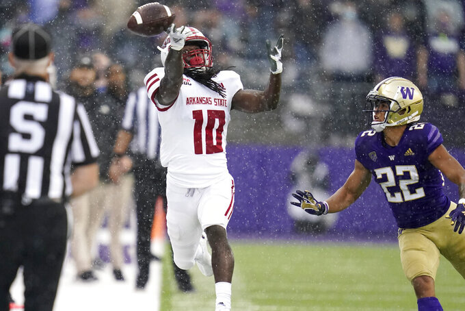 Arkansas State's Te'Vailance Hunt (10) can't make the catch thrown his way as Washington's Trent McDuffie defends in the first half of an NCAA college football game, Saturday, Sept. 18, 2021, in Seattle. (AP Photo/Elaine Thompson)
