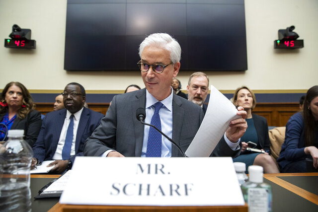 FILE - In this March 10, 2020 file photo, Wells Fargo CEO and President Charles Scharf is seated before he testifies during a hearing of the House Financial Services Committee, on Capitol Hill, in Washington. Scharf apologized Wednesday, Sept. 23 for comments he made that dismissed concerns that the banking industry, which has a long history of racist behavior, wasn't doing enough to promote and retain diverse talent. (AP Photo/Alex Brandon, File)
