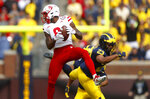 Nebraska wide receiver Stanley Morgan Jr. (8) catches a pass as Michigan defensive back Tyree Kinnel (23) defends in the first half of an NCAA football game in Ann Arbor, Mich., Saturday, Sept. 22, 2018. (AP Photo/Paul Sancya)