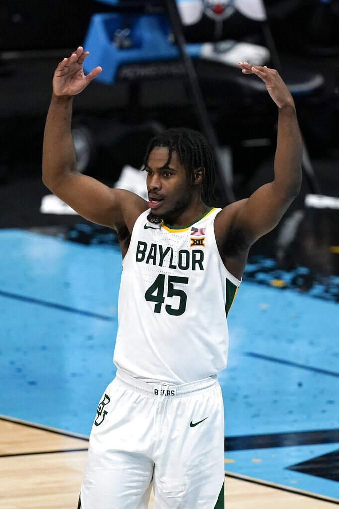 Baylor guard Davion Mitchell celebrates at the end of a men's Final Four NCAA college basketball tournament semifinal game against Houston, Saturday, April 3, 2021, at Lucas Oil Stadium in Indianapolis. Baylor won 78-59. (AP Photo/Michael Conroy)
