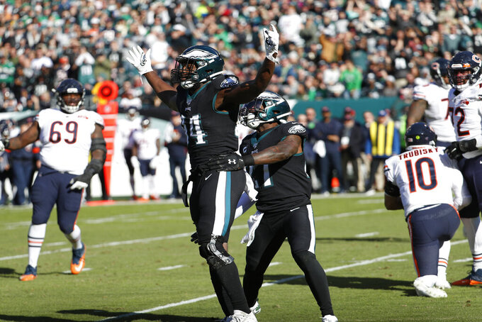 Philadelphia Eagles' Josh Sweat (94) celebrates after tackling Chicago Bears' Mitchell Trubisky (10) during the first half of an NFL football game, Sunday, Nov. 3, 2019, in Philadelphia. (AP Photo/Chris Szagola)