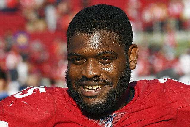 FILE - San Francisco 49ers left guard Laken Tomlinson (75) smiles on the field after the 49ers defeated the Los Angeles Rams 20-7 in an NFL football game on Sunday, Oct. 13, 2019 in Los Angeles. The 49ers have announced the nine recipients of grants the team is awarding as part of a $1 million commitment to organizations creating social change. The final picks were determined by the 49ers representatives on the Players Social Justice Council, including Tomlinson.(AP Photo/John Cordes, File)