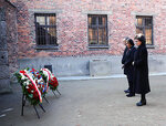In this image provided by the US Consulate General in Krakow, U.S. House Speaker Nancy Pelosi, center, and speakers of Poland's parliament lay wreaths at the executions Death Wall of the World War II Nazi death camp of Auschwitz-Birkenau during a visit to the site of the former camp just days before the 75th anniversary of its 1945 liberation by the Soviet troops, at the Auschwitz-Birkenau Museum, in southern Poland, on Tuesday, Jan. 21, 2020. (US Consulate General in Krakow via AP)