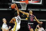 Iowa forward Keegan Murray (15) blocks a shot by Northern Illinois guard Anthony Crump (50) during the first half of an NCAA college basketball game, Sunday, Dec. 13, 2020, in Iowa City, Iowa. (AP Photo/Charlie Neibergall)
