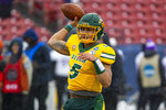 North Dakota State quarterback Trey Lance (5) warms up before the FCS championship NCAA college football game against James Madison, Saturday, Jan. 11, 2020, in Frisco, Texas. (AP Photo/Sam Hodde)