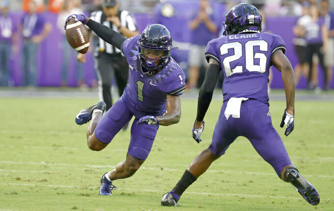 TCU cornerback Tre'Vius Hodges-Tomlinson (1) intercepts a pass as safety Bud Clark (26) looks on against Duquesne during the first half of an NCAA college football game Saturday, Sept. 4, 2021, in Fort Worth, Texas. (AP Photo/Ron Jenkins)