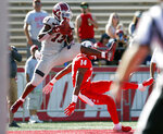 New Mexico State wide receiver Tony Nicholson (13) catches a pass in the end zone to score a touchdown against New Mexico cornerback Michael LoVett (14) during the first half of an NCAA college football game on Saturday, Sept. 21, 2019 in Albuquerque, N.M. (AP Photo/Andres Leighton)
