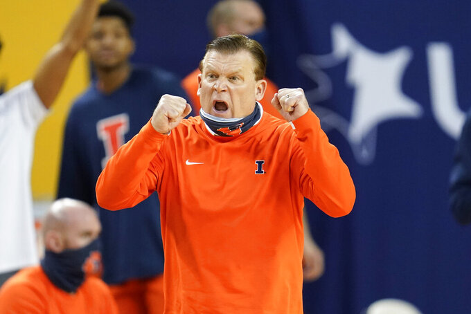 FILE - Illinois head coach Brad Underwood reacts to a play against Michigan in the second half of an NCAA college basketball game in Ann Arbor, Mich., in this Tuesday, March 2, 2021, file photo. Nobody will get a lump in their throat or start sizing up glass slippers for programs like these — Alabama, Illinois, Baylor.  They're not underdogs. They're hardly unknown. What they are is a group of new teams with well-recognized names in the NCAA Tournament, and they're hoping to keep making life hard on the programs that have long had a stranglehold on March. (AP Photo/Paul Sancya, File)