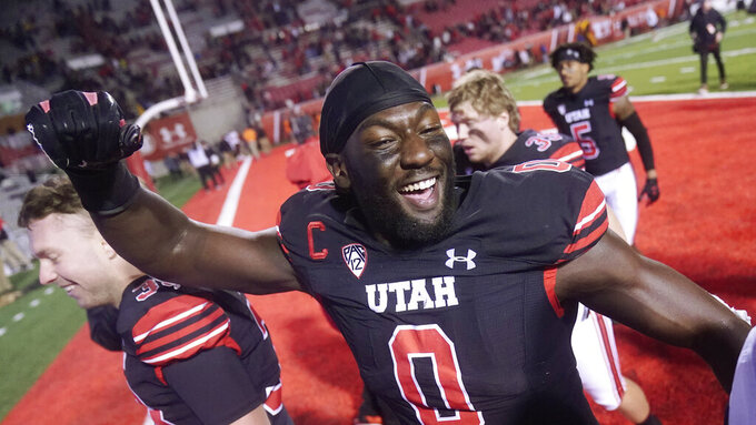 FILE - Utah linebacker Devin Lloyd (0) celebrates as he walks off the field following their NCAA college football game against Arizona State in Salt Lake City, in this Saturday, Oct. 16, 2021, file photo. Lloyd was selected to The Associated Press Midseason All-America team, announced Tuesday, Oct. 19, 2021.  (AP Photo/Rick Bowmer, File)