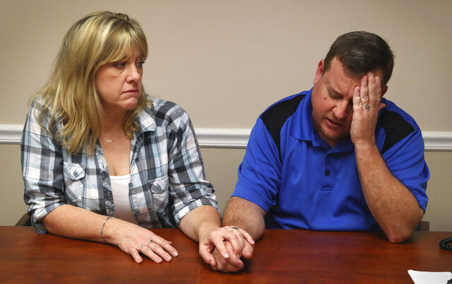 FILE- In this Feb. 17, 2018 photo, Kimberly and James Snead recount the day of the shooting at Marjory Stonemason Douglas High School in Parkland, Fla., where 17 people were killed in a mass shooting. The Snead's, who had taken suspected gunman Nikolas Cruz in their home after his mother died, told the Sun-Sentinel newspaper they had no idea the extent of Cruz's issues. In a letter released Tuesday, July 28, 2020, that is part of a legal agreement to settle numerous civil lawsuits, the Snead's said they were wrong in allowing Cruz to store his firearms in their home, including the AR-15 used in the mass shooting. (Susan Stocker/South Florida Sun-Sentinel via AP, File)