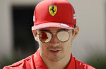 CAPTION CORRECTS DRIVER ID  Charles Leclerc of Ferrari walks to the paddock prior to the third free practice at the Formula One Bahrain International Circuit in Sakhir, Bahrain, Saturday, March 30, 2019. (AP Photo/Luca Bruno)
