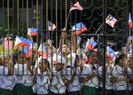 Students hold Philippine and Malaysian national flags as they wait the arrival of Malaysian Prime Minister Mahathir Mohamad at the Malacanang presidential palace in Manila, Philippines on Thursday, March 7, 2019. (AP Photo/Aaron Favila)