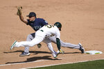 Seattle Mariners' Evan White, left, forces out Oakland Athletics' Nate Orf at first base during the sixth inning of a baseball game in Oakland, Calif., Sunday, Sept. 27, 2020. (AP Photo/Jeff Chiu)