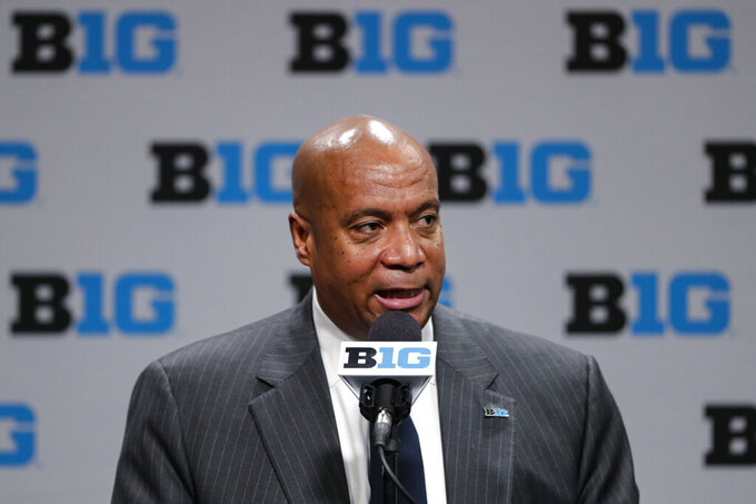 FILE - In this March 12, 2020, file photo, Big Ten Commissioner Kevin Warren addresses the media in Indianapolis. The Big Ten's plan to play football this fall includes trying to save lives in the future. The conference announced Wednesday, Sept. 16, 2020, it would have a football season this fall. The Big Ten is setting up a cardiac registry to study the effects COVID-19 has on student-athletes' hearts. Big Ten Commissioner Kevin Warren said it will help all students, surrounding communities, and the entire nation. (AP Photo/Michael Conroy, File)