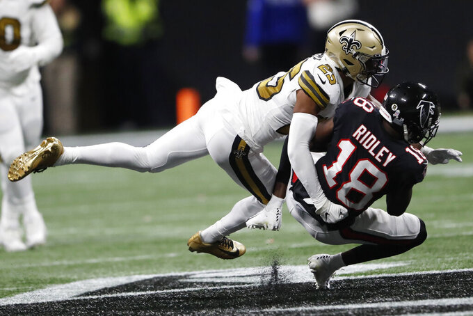 New Orleans Saints cornerback Eli Apple (25) tackles Atlanta Falcons wide receiver Calvin Ridley (18) during the second half of an NFL football game, Thursday, Nov. 28, 2019, in Atlanta. (AP Photo/John Bazemore)