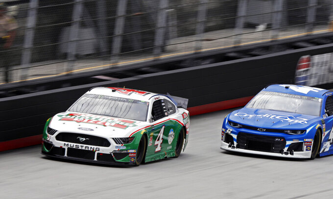 Kevin Harvick (4) leads Kyle Larson (42) during a NASCAR Cup Series auto race, Sunday, April 7, 2019, in Bristol, Tenn. Harvick failed inspection three times before the race. (AP Photo/Wade Payne)(AP Photo/Wade Payne)