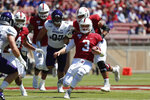 Stanford quarterback K.J. Costello (3) runs with the ball against Northwestern defensive lineman Joe Gaziano (97) in the first quarter of an NCAA college football game in Stanford, Calif., Saturday, Aug. 31, 2019. (AP Photo/Josie Lepe)