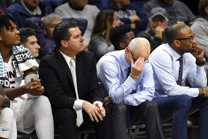 With his team trailing in the closing minutes, Connecticut head coach Dan Hurley puts his head in his hands in the second half of an NCAA college basketball game against St. Joseph's Wednesday, Nov. 13, 2019, in Storrs, Conn. (AP Photo/Stephen Dunn)