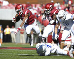 Arkansas running back Rakeem Boyd, top, gets past Tulsa defender Bryson Powers as he runs the ball in the first half of an NCAA college football game Saturday, Oct. 20, 2018, in Fayetteville, Ark. (AP Photo/Michael Woods)