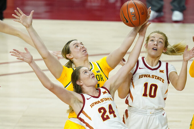 FILE - Baylor forward Caitlin Bickle fights for a rebound with Iowa State guard Ashley Joens (24) and guard Kylie Feuerbach (10) during the first half of an NCAA college basketball game in Ames, Iowa, in this Sunday, Jan. 31, 2021, file photo. The Big 12 women's tournament begins Thursday, March 12. Iowa State junior Ashley Joens is the Big 12's leading scorer. (AP Photo/Charlie Neibergall, File)