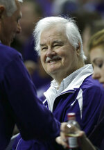 FILE - In this Jan. 24, 2015, file photo, Former Kansas State basketball coach Tex Winter smiles when greeted in the crowd during the first half of the team's NCAA college basketball game against Oklahoma State in Manhattan, Kan. Winter, the innovative