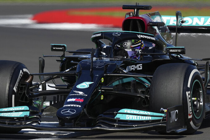 Mercedes driver Lewis Hamilton of Britain steers his car during the British Formula One Grand Prix, at the Silverstone circuit, in Silverstone, England, Sunday, July 18, 2021. (AP Photo/Jon Super)