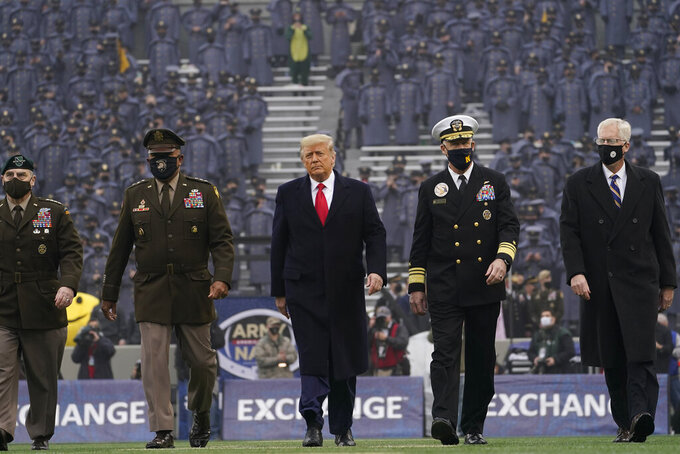 President Donald Trump walks on the field before the 121st Army-Navy Football Game in Michie Stadium at the United States Military Academy, Saturday, Dec. 12, 2020, in West Point, N.Y. (AP Photo/Andrew Harnik)