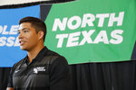 FILE - In this July 17, 2019, file photo, North Texas quarterback Mason Fine responds to questions in an interview during the Conference USA college football media day in Frisco, Texas. North Texas is favored to win West Division in Conference USA. Fine is already UNT's career passing leader and has been Conference USA's top offensive player each of the past two seasons. Fine is the FBS active leader with 9,417 yards passing and 64 touchdowns. (AP Photo/Tony Gutierrez, File)