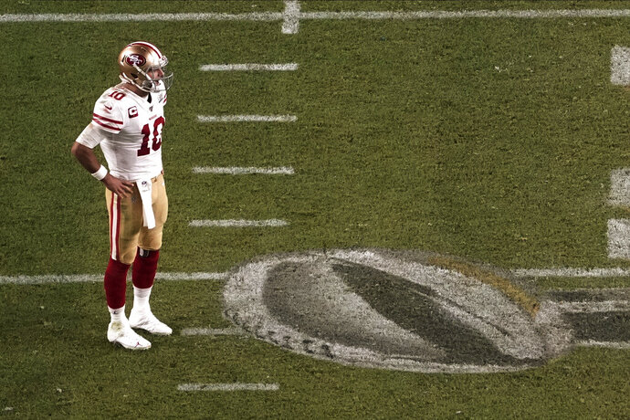 San Francisco 49ers quarterback Jimmy Garoppolo (10) stands on the field, during the second half of the NFL Super Bowl 54 football game against the Kansas City Chiefs', Sunday, Feb. 2, 2020, in Miami Gardens, Fla. (AP Photo/Morry Gash)